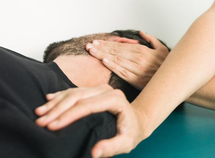 Man Getting Shoulder Stretched