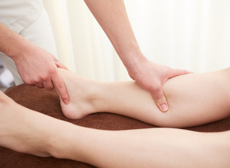 Osteopath Stretching Clients Leg